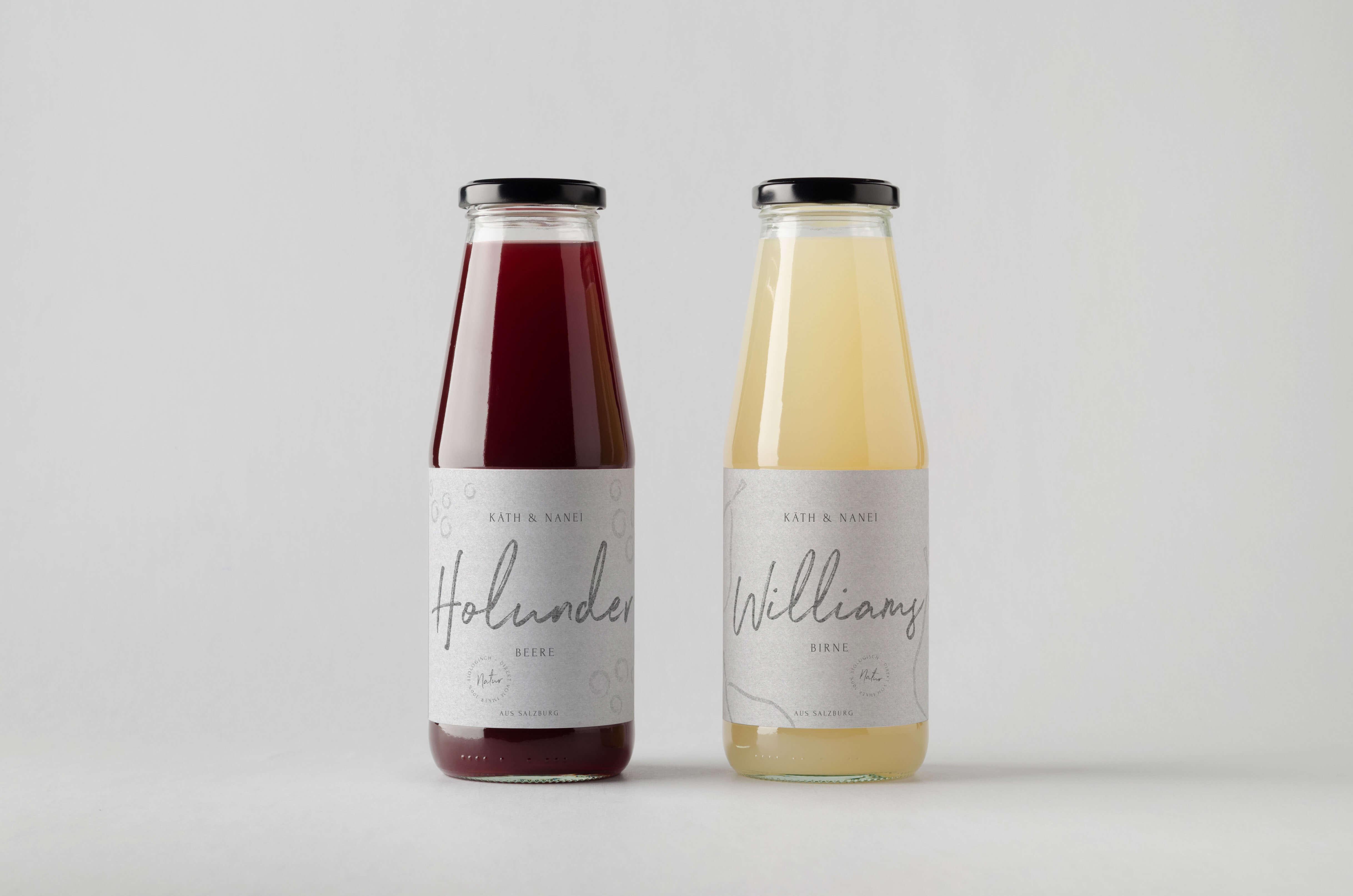 Juice Bottle Mock-Up – Two Bottles. Blank Label